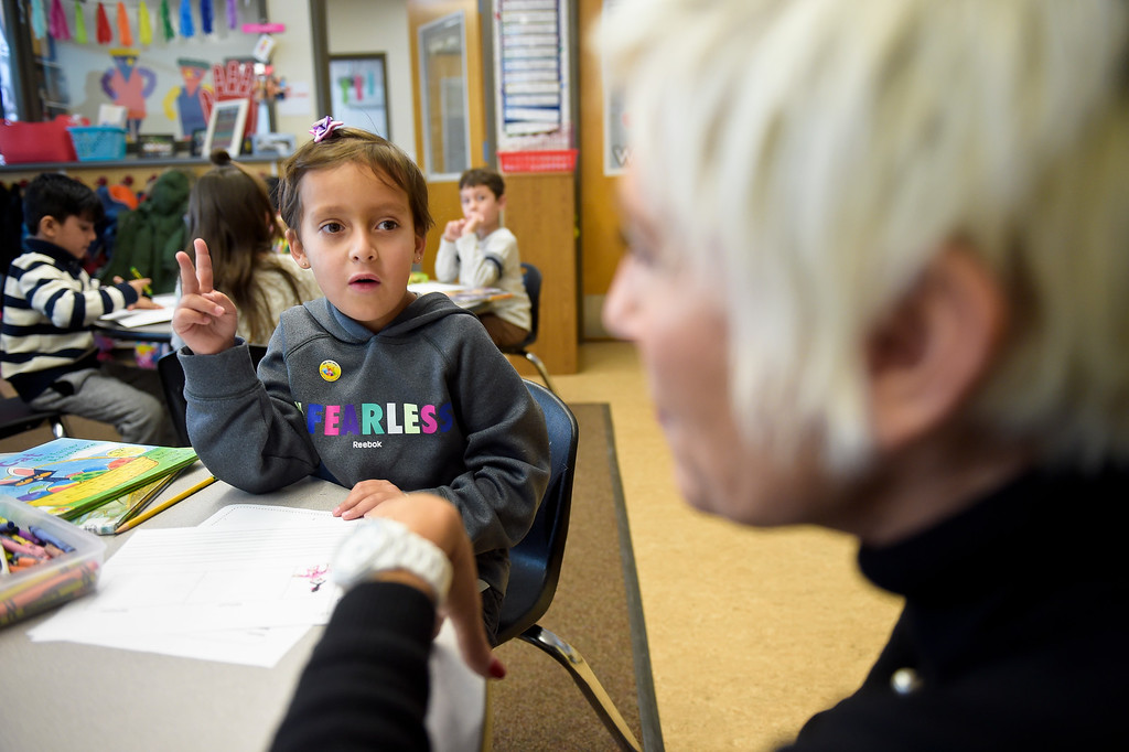 . ERIE, CO - JANUARY 24: Kindergartner Kellen Graham gets help from teacher Renee Quijas in a full-day kindergarten class at Erie\'s Red Hawk Elementary January 24, 2019. Red Hawk has three classrooms for full-day kindergarten. To view more photos visit timescall.com. (Photo by Lewis Geyer/Staff Photographer)