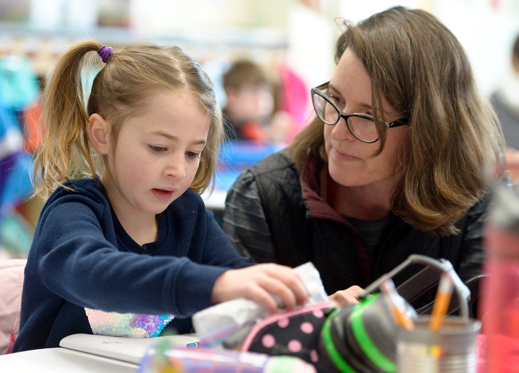 . ERIE, CO - JANUARY 24: Kindergartner Elliot McDonald gets help from her teacher Deirdre Nagle in her full-day kindergarten class at Erie\'s Red Hawk Elementary January 24, 2019. Red Hawk has three classrooms for full-day kindergarten. To view more photos visit timescall.com. (Photo by Lewis Geyer/Staff Photographer)