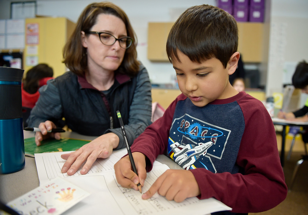 . ERIE, CO - JANUARY 24: Teacher Deirdre Nagle helps kindergartner Graydon Beck with a writing assignment in her full-day kindergarten class at Erie\'s Red Hawk Elementary January 24, 2019. Red Hawk has three classrooms for full-day kindergarten. To view more photos visit timescall.com. (Photo by Lewis Geyer/Staff Photographer)