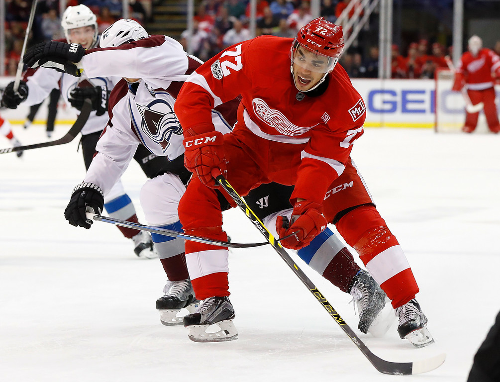 . Detroit Red Wings center Andreas Athanasiou (72) battles for position with Colorado Avalanche left wing Gabriel Landeskog (92) in the second period of an NHL hockey game Saturday, March 18, 2017, in Detroit. (AP Photo/Paul Sancya)