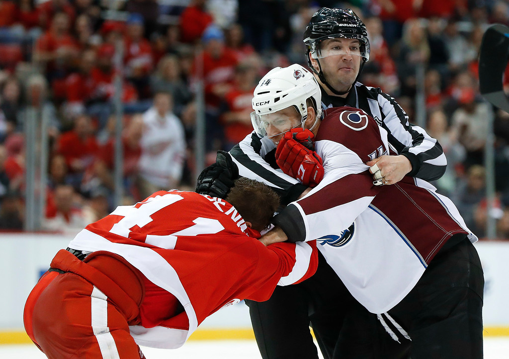 . Detroit Red Wings center Luke Glendening (41) and Colorado Avalanche left wing Blake Comeau (14) are separated in the third period of an NHL hockey game Saturday, March 18, 2017, in Detroit. (AP Photo/Paul Sancya)