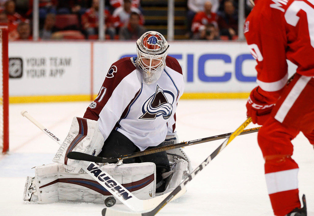 . Colorado Avalanche goalie Calvin Pickard (31) stops a Detroit Red Wings left wing Drew Miller (20) shot in the second period of an NHL hockey game Saturday, March 18, 2017, in Detroit. (AP Photo/Paul Sancya)