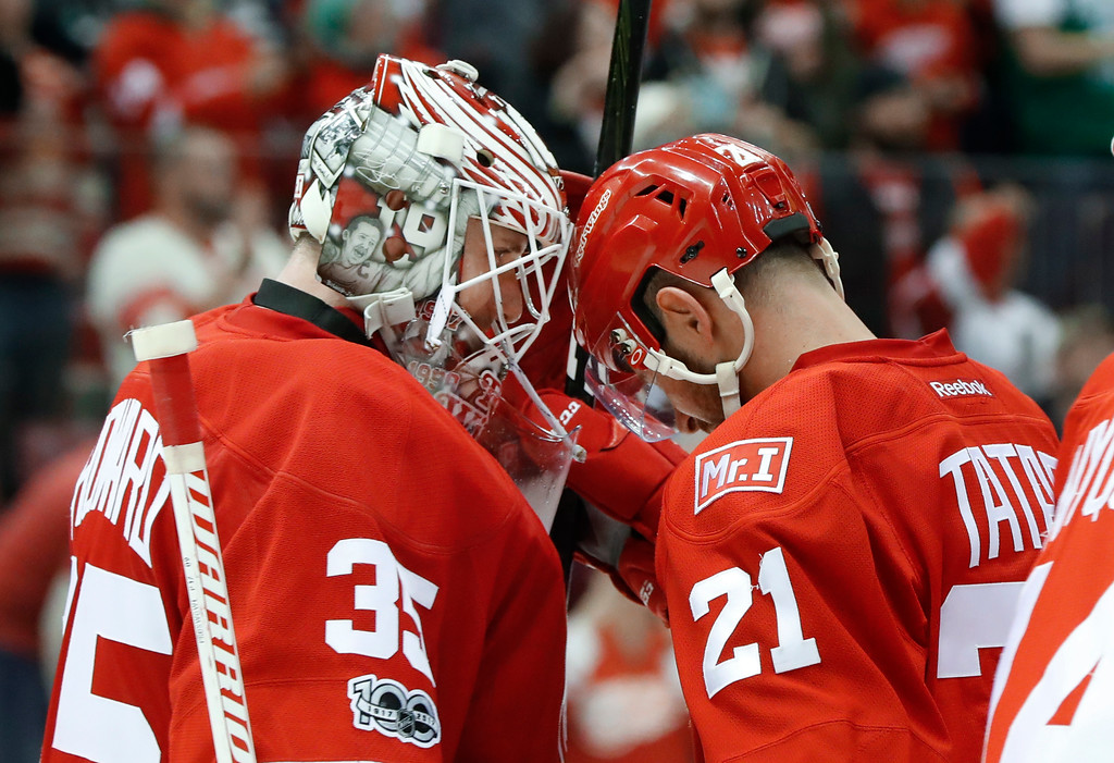 . Detroit Red Wings goalie Jimmy Howard (35) and Tomas Tatar (21) celebrate their 5-1 win against the Colorado Avalanche after an NHL hockey game Saturday, March 18, 2017, in Detroit. (AP Photo/Paul Sancya)