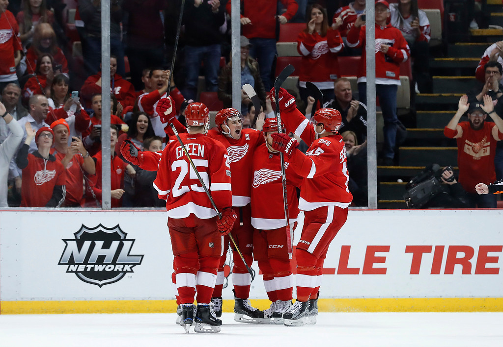 . Detroit Red Wings\' Dylan Larkin, second from left, celebrates his goal against the Colorado Avalanche in the third period of an NHL hockey game Saturday, March 18, 2017, in Detroit. (AP Photo/Paul Sancya)