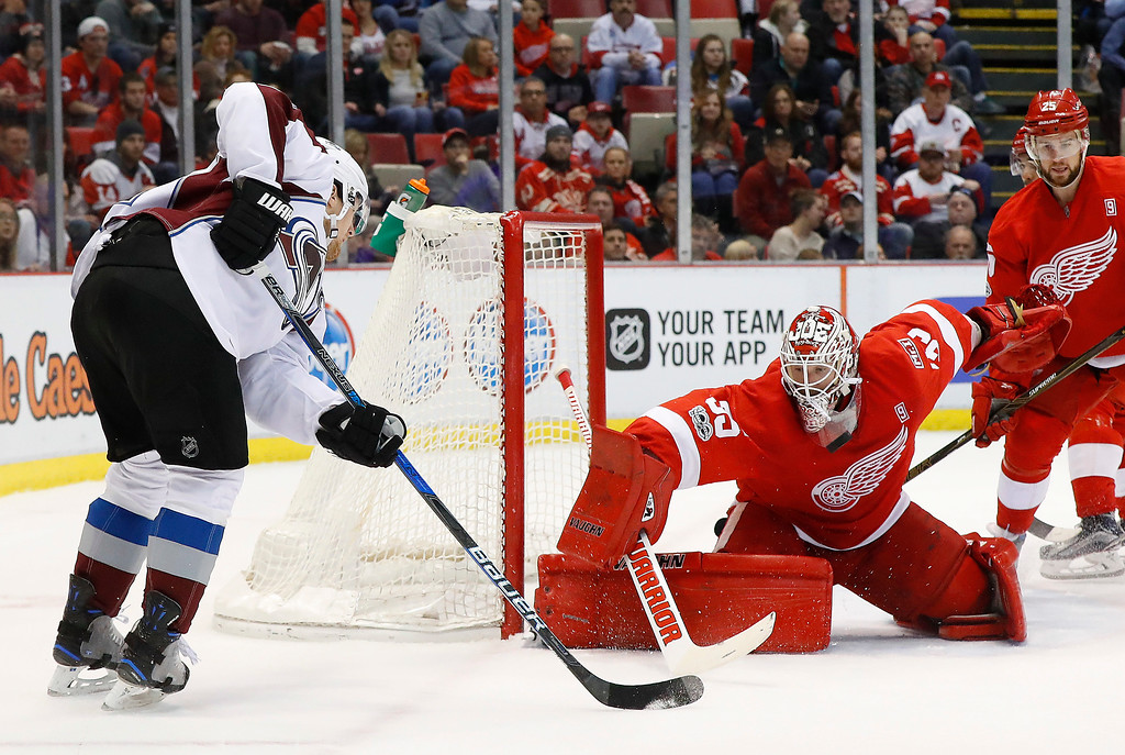 . Detroit Red Wings goalie Jimmy Howard (35) stops a Colorado Avalanche left wing Gabriel Landeskog (92) shot in the first period of an NHL hockey game Saturday, March 18, 2017, in Detroit. (AP Photo/Paul Sancya)