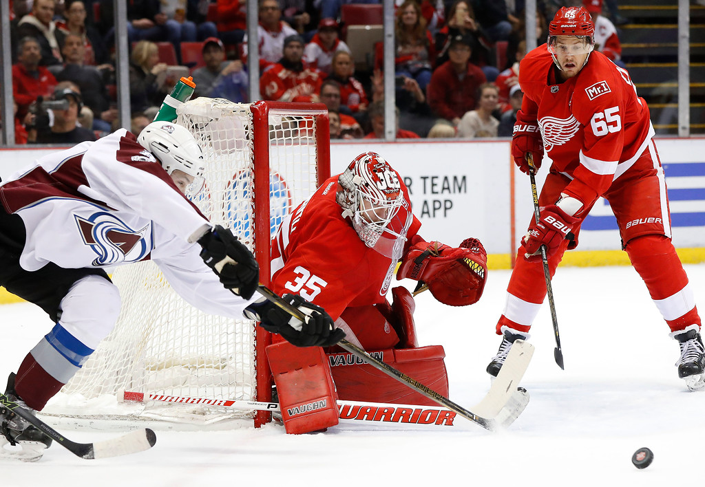 . Detroit Red Wings goalie Jimmy Howard (35) blocks a Colorado Avalanche center Joe Colborne (8) shot in the first period of an NHL hockey game Saturday, March 18, 2017, in Detroit. (AP Photo/Paul Sancya)