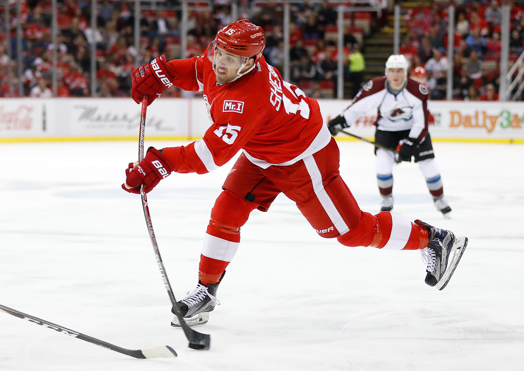 . Detroit Red Wings center Riley Sheahan (15) shoots against the Colorado Avalanche in the second period of an NHL hockey game Saturday, March 18, 2017, in Detroit. (AP Photo/Paul Sancya)