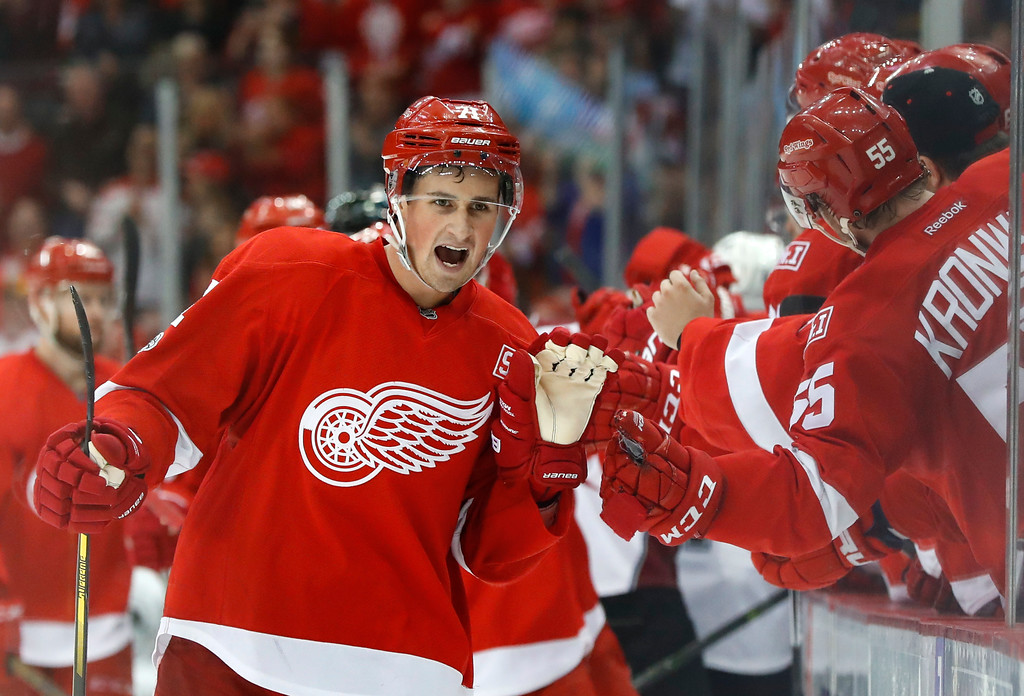 . Detroit Red Wings\' Dylan Larkin (71) celebrates his goal against the Colorado Avalanche in the third period of an NHL hockey game Saturday, March 18, 2017, in Detroit. Detroit won 5-1. (AP Photo/Paul Sancya)