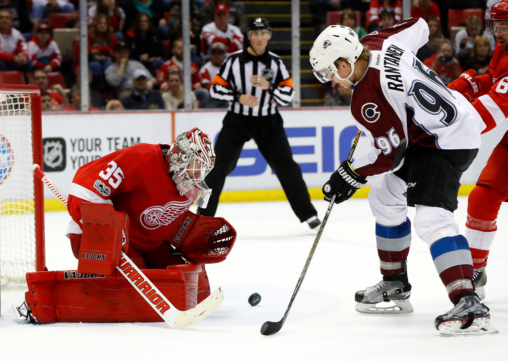 . Detroit Red Wings goalie Jimmy Howard (35) stops a Colorado Avalanche right wing Mikko Rantanen (96) shot in the third period of an NHL hockey game Saturday, March 18, 2017, in Detroit. (AP Photo/Paul Sancya)