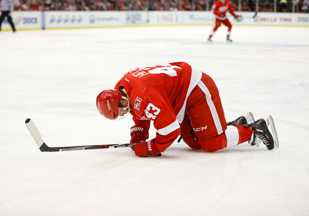 . Detroit Red Wings center Darren Helm (43) gets up from the ice after being checked against the Colorado Avalanche in the second period of an NHL hockey game Saturday, March 18, 2017, in Detroit. Helm left the ice. (AP Photo/Paul Sancya)