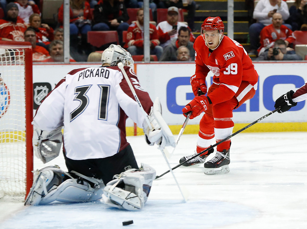 . Detroit Red Wings right wing Anthony Mantha (39) shoots on Colorado Avalanche goalie Calvin Pickard (31) in the second period of an NHL hockey game Saturday, March 18, 2017, in Detroit. (AP Photo/Paul Sancya)