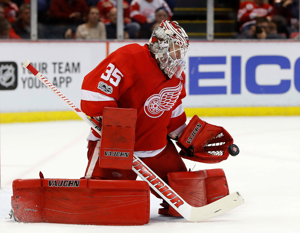 . Detroit Red Wings goalie Jimmy Howard (35) stops a Colorado Avalanche shot in the first period of an NHL hockey game Saturday, March 18, 2017, in Detroit. (AP Photo/Paul Sancya)
