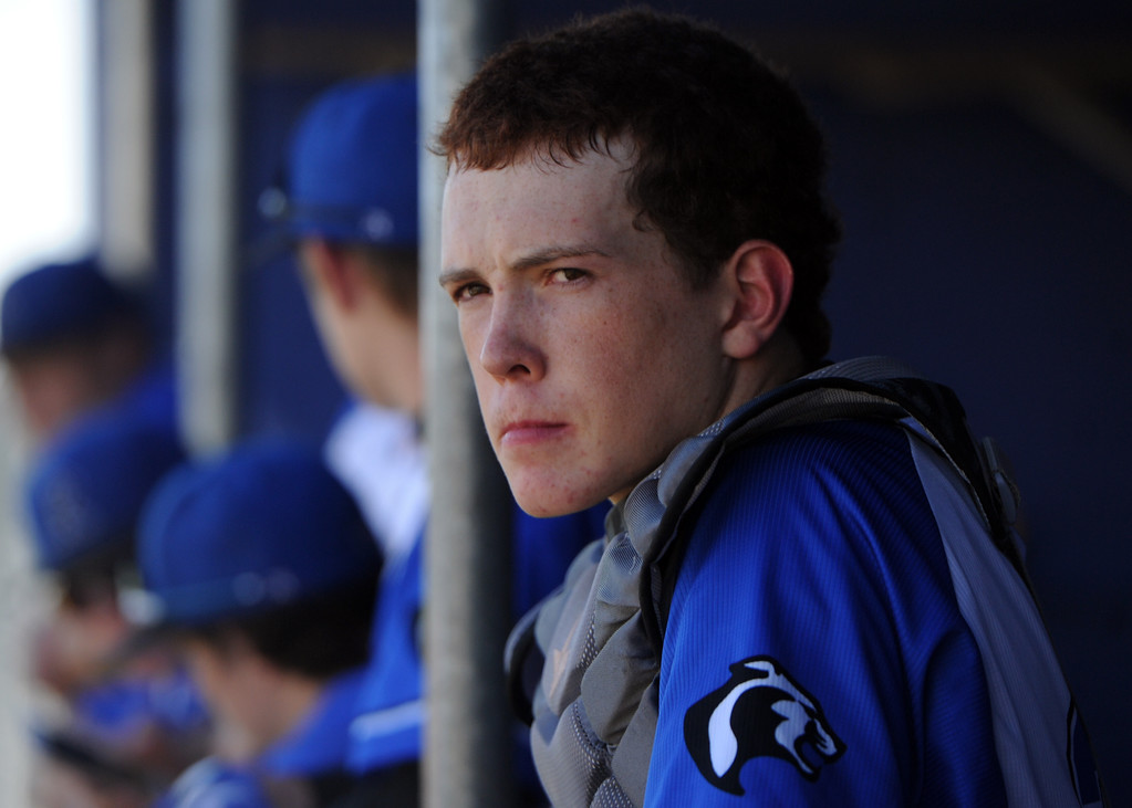 . Resurrection Christian catcher Josiah Lincoln waits in the dugout before a game against Eaton on Friday, May 4, 2018 at Resurrection Christian School in Loveland. (Sean Star/Loveland Reporter-Herald)