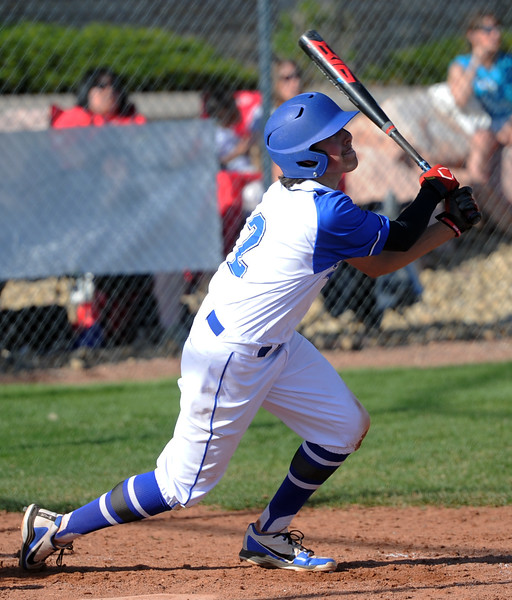 Resurrection Christian's Jackson Romero follows through on a triple during a game against Eaton on Friday, May 4, 2018 at Resurrection Christian School in Loveland. (Sean Star/Loveland Reporter-Herald)