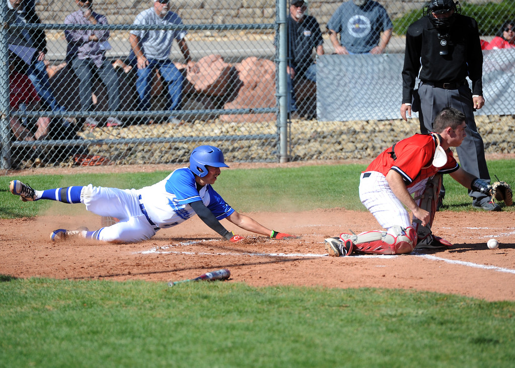 . Resurrection Christian\'s Jackson Romero slides safely into home for the Cougars\' lone run during Friday\'s 7-1 loss to Eaton at RCS. (Sean Star/Loveland Reporter-Herald)