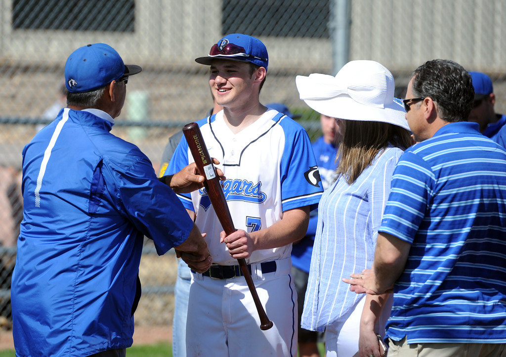 . Resurrection Christian senior Christian Cox receives a commemorative bat for senior day from coach Ernie Romero before a game against Eaton on Friday, May 4, 2018 at Resurrection Christian School in Loveland. (Sean Star/Loveland Reporter-Herald)