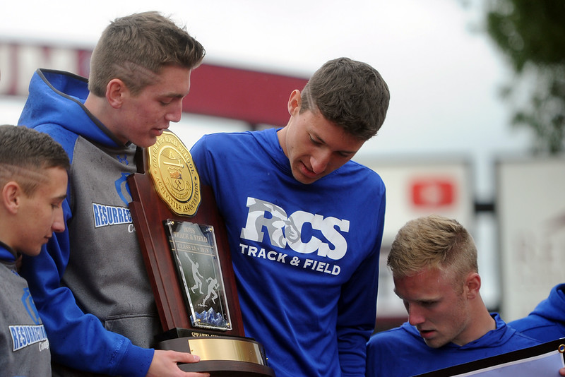 From left, Dalton Armstrong, Christian Fagerlin, Ben Jackson and Tanner Applebee accept the 2A state championship trophy on Saturday at Jeffco Stadium. (Sean Star/Loveland Reporter-Herald)