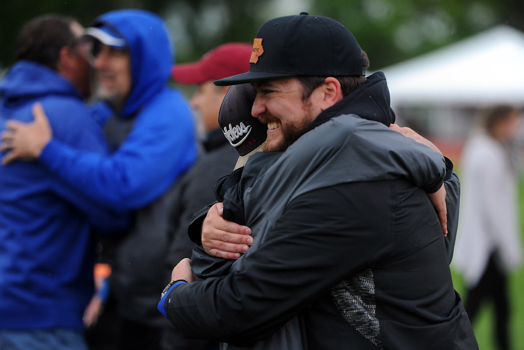 . Resurrection Christian coach Luke Appleton, right, hugs Trenton Brand while celebrating their 2A state track and field championship on Saturday at Jeffco Stadium. (Sean Star/Loveland Reporter-Herald)