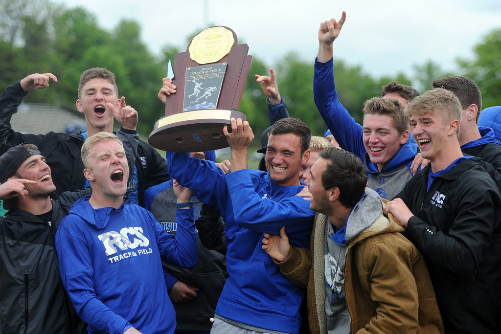 . Resurrection Christian celebrates its 2A boys state track and field championship on Saturday at Jeffco Stadium. (Sean Star/Loveland Reporter-Herald)