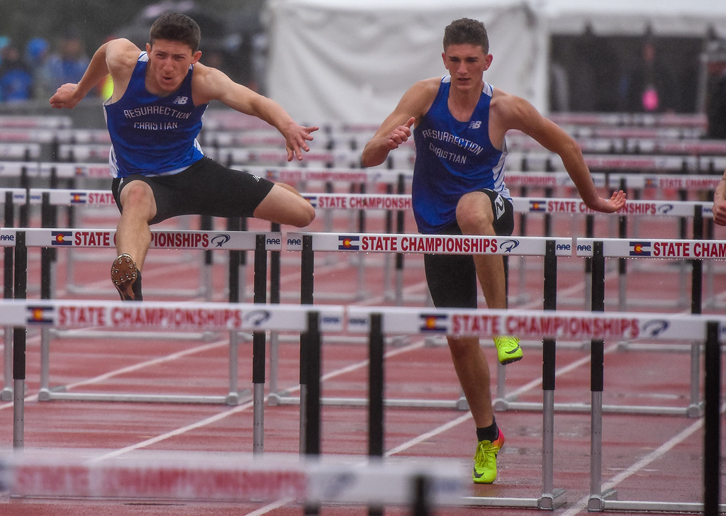 . Resurrection Christian\'s Ben Jackson, left, and teammate Ryan Applebee race the 2A 110-meter hurdles at the 2018 state track and field meet Saturday May 19, 2018 at Jeffco Stadium in Lakewood. (Cris Tiller / Loveland Reporter-Herald)