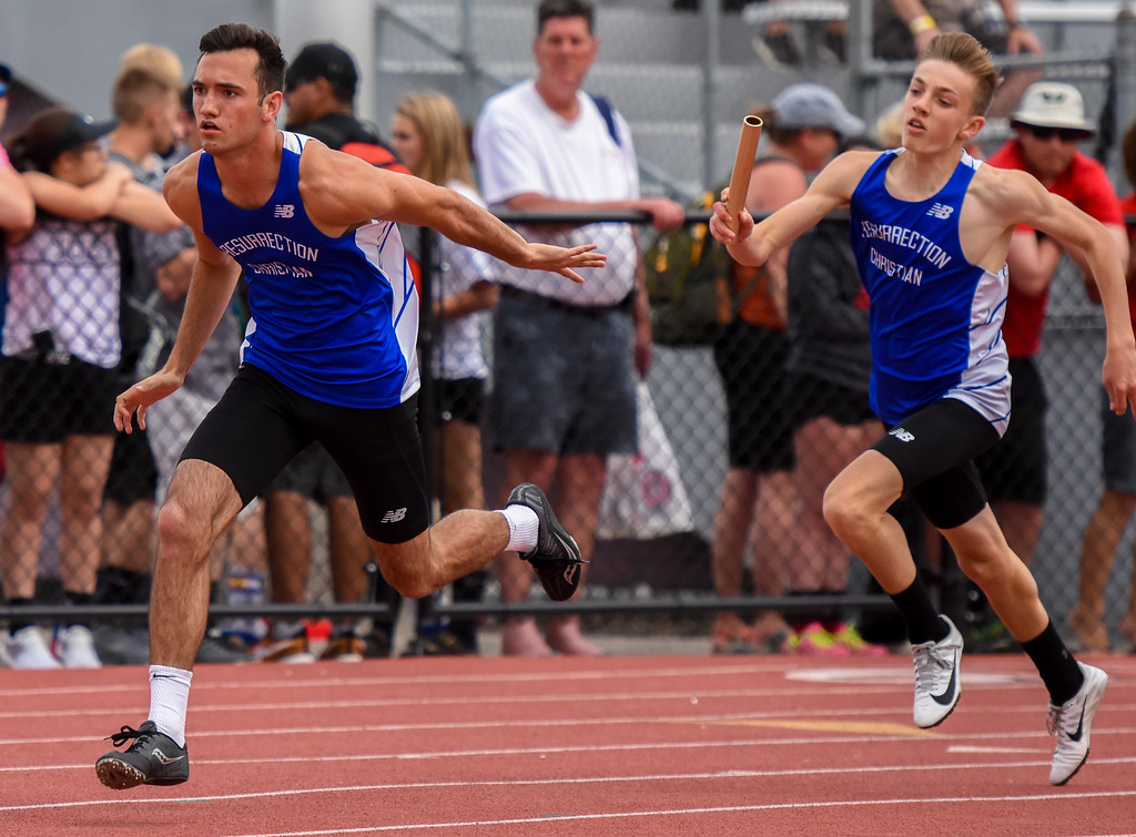 . Resurrection Christian\'s Colton Stahla, left, awaits the exchange from Braycen Buxman during the 4x200-meter relay at the 2018 state track and field meet Thursday May 17, 2018 at Jeffco Stadium in Lakewood. (Cris Tiller / Loveland Reporter-Herald)