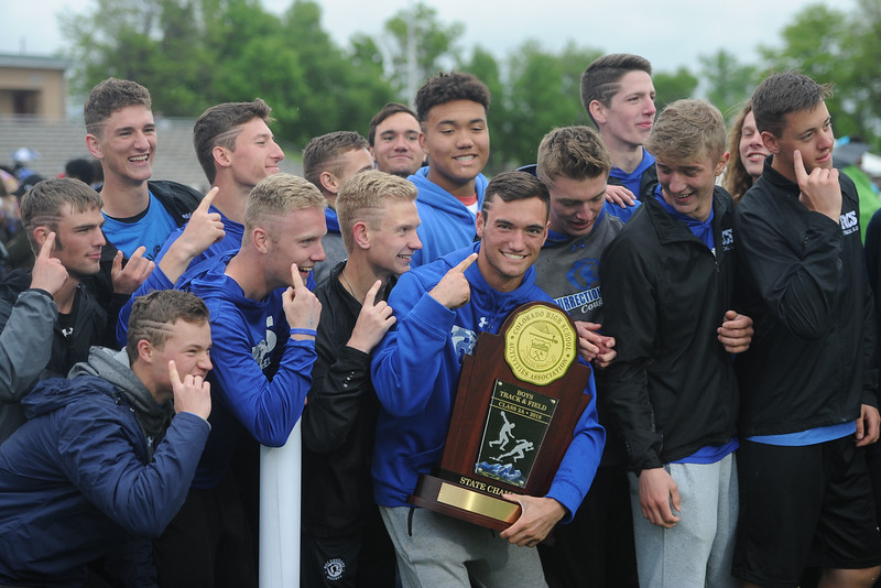 Resurrection Christian poses with its 2A state championship trophy on Saturday at Jeffco Stadium. (Sean Star/Loveland Reporter-Herald)