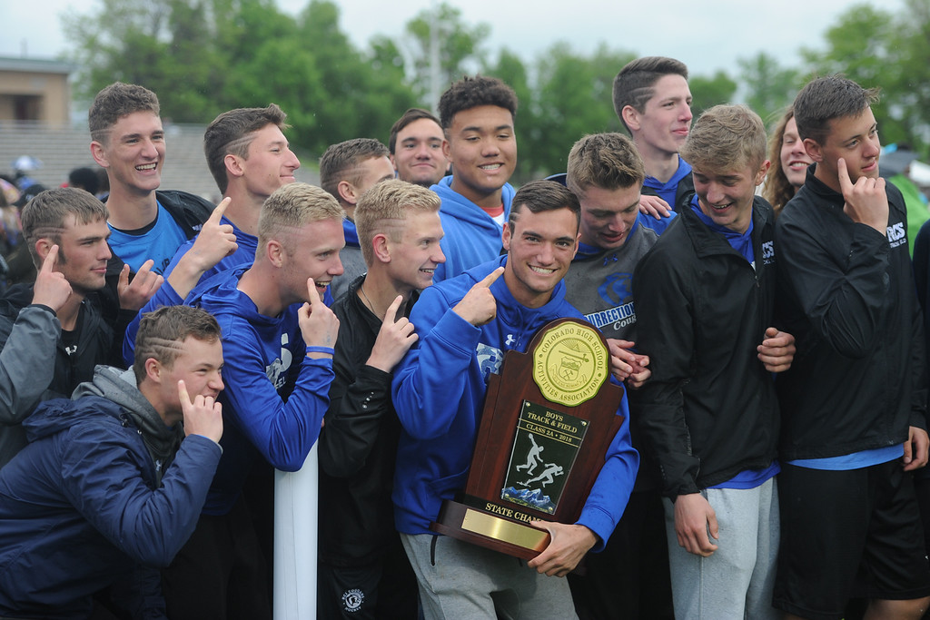 . Resurrection Christian poses with its 2A state championship trophy on Saturday at Jeffco Stadium. (Sean Star/Loveland Reporter-Herald)
