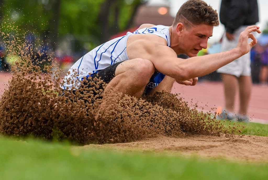 . Resurrection Christian\'s Ryan Applebee plunges into the 2A triple jump sand pit at the 2018 state track and field meet Friday May 18, 2018 at Jeffco Stadium in Lakewood. (Cris Tiller / Loveland Reporter-Herald)
