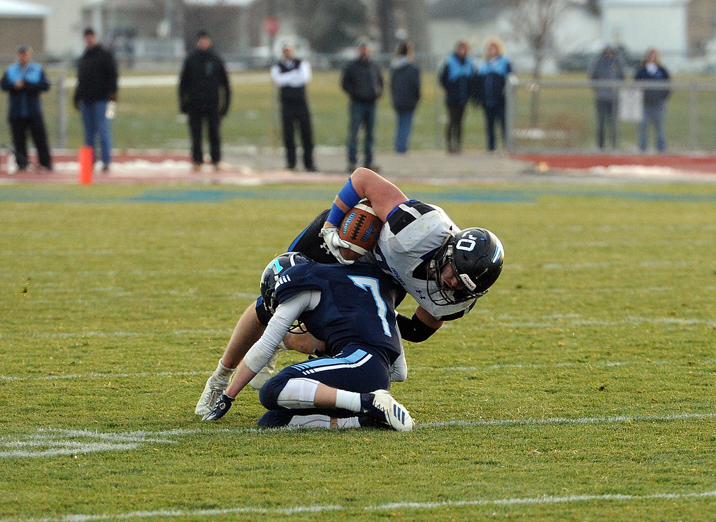 . Kyle Lueck is tackled by a Platte Valley defender on Sunday, Nov. 18, 2018 at Platte Valley High School. (Colin Barnard/Loveland Reporter-Herald)