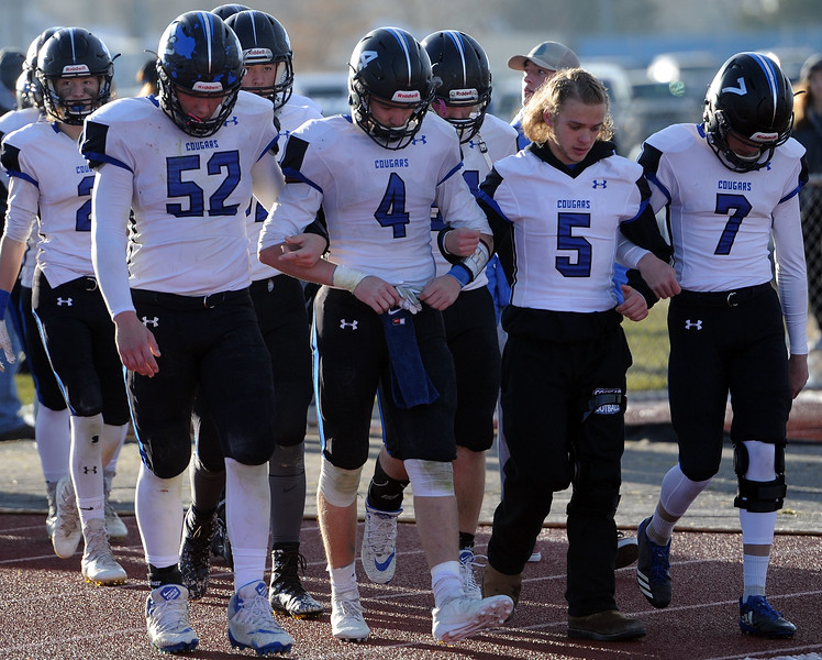 Resurrection Christian's captains lead the team onto the field for the second half against Platte Valley. (Colin Barnard/Loveland Reporter-Herald)