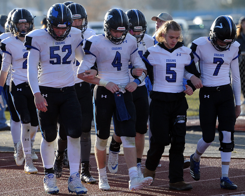 . Resurrection Christian\'s captains lead the team onto the field for the second half against Platte Valley. (Colin Barnard/Loveland Reporter-Herald)