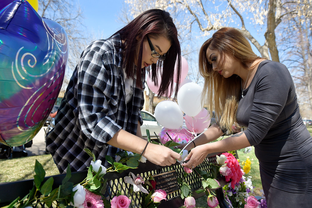 . LONGMONT, CO - APRIL 7: Nicole Romero, left, and Jessica Reyes decorate the bench being dedicated to their sister Rita Gutierrez-Garcia on Rita\'s birthday April 7, 2019 at Thompson Park. Gutierrez-Garcia disappeared over a year ago. To view more photos visit timescall.com. (Photo by Lewis Geyer/Staff Photographer)