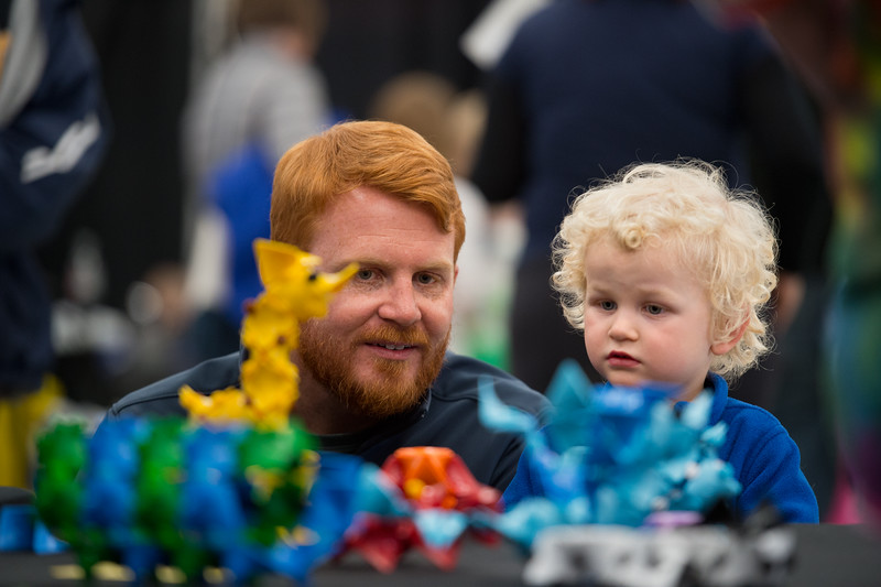 "Julian Kain and his son Henry Kain, 3, look at animal figures constructed out of HyPars during the Rocky Mountain STEAM Fest at the Boulder County Fairgrounds in Longmont on Sunday.<br /> More photos:  <a href=""http://www.dailycamera.com"">http://www.dailycamera.com</a><br /> Autumn Parry/Staff Photographer<br /> May 1, 2016"
