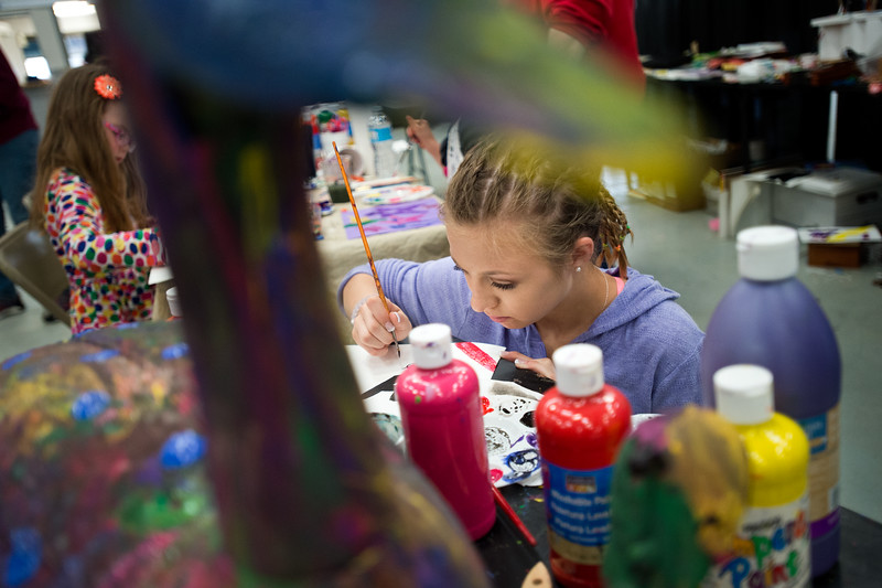 "McKayla Parmley, 14, paints a picture at the Creatovation Station held by Arts Longmont during the Rocky Mountain STEAM Fest at the Boulder County Fairgrounds in Longmont on Sunday. The festival encourages hands-on interactive building related to the arts, technology and science. More photos:  <a href=""http://www.dailycamera.com"">http://www.dailycamera.com</a><br /> Autumn Parry/Staff Photographer<br /> May 1, 2016"