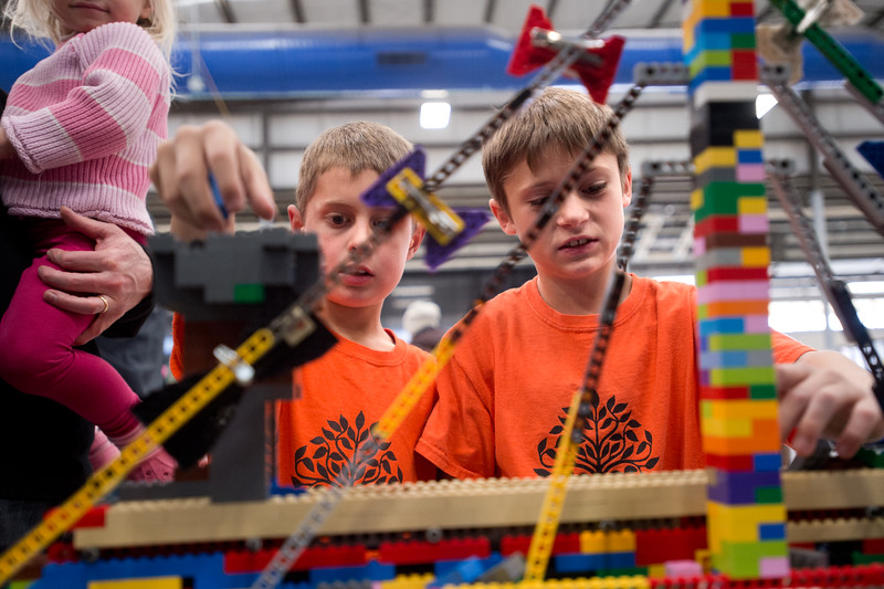 "Andrew Weaver, 10, (left) and Matt Dietz, 10, drop legos on a conveyor belt constructed by Play-Well TEKnologies during the Rocky Mountain STEAM Fest at the Boulder County Fairgrounds in Longmont. The lego invention is intended to teach children about its parts and purpose. <br /> More photos:  <a href=""http://www.dailycamera.com"">http://www.dailycamera.com</a><br /> Autumn Parry/Staff Photographer<br /> May 1, 2016"