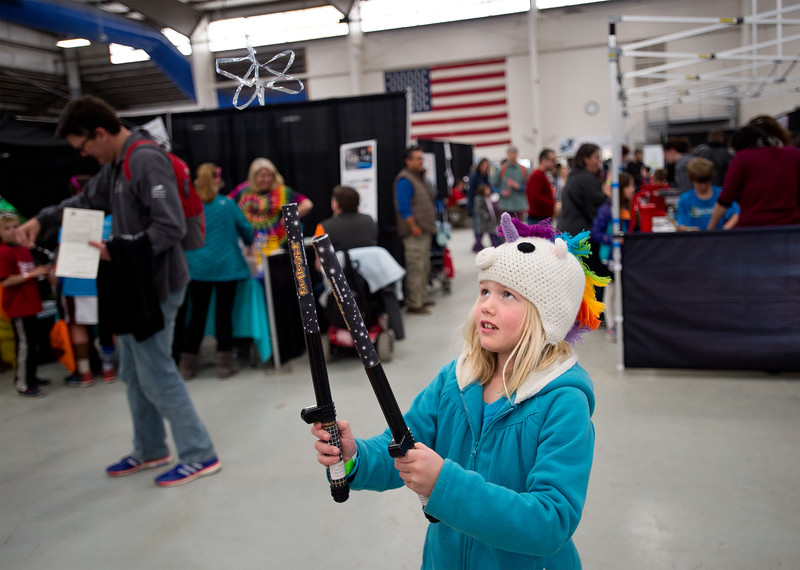 "Julia Gillespie, 7, uses a Fun Fly Stick which uses static electricity to keep a piece of mylar afloat, during the Rocky Mountain STEAM Fest at the Boulder County Fairgrounds in Longmont.<br /> More photos:  <a href=""http://www.dailycamera.com"">http://www.dailycamera.com</a><br /> Autumn Parry/Staff Photographer<br /> May 1, 2016"