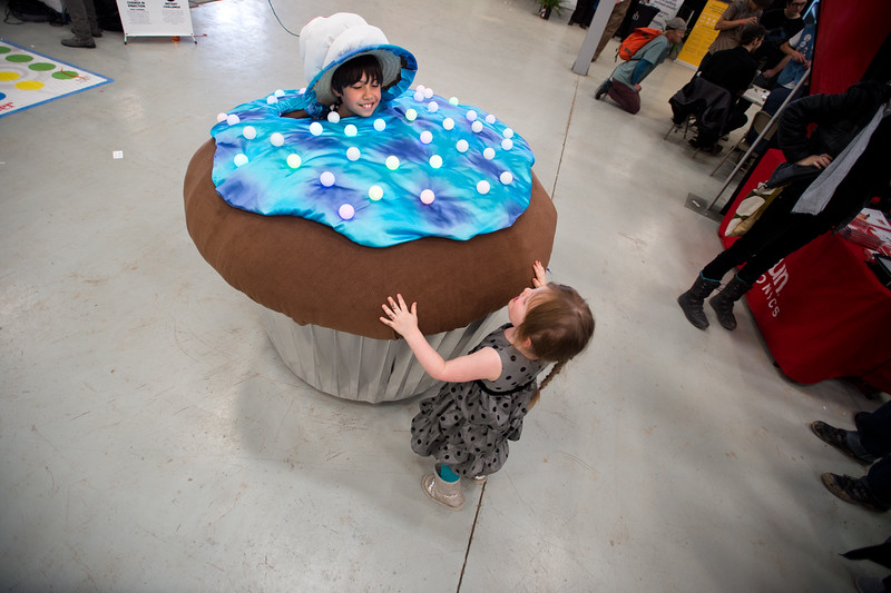 """Ava James, 3, greets Leo Norton, 10, who is dressed as a cupcake during the Rocky Mountain STEAM Fest at the Boulder County Fairgrounds in Longmont on Sunday. <br /> More photos:  <a href=""""http://www.dailycamera.com"""">http://www.dailycamera.com</a><br /> Autumn Parry/Staff Photographer<br /> May 1, 2016"""