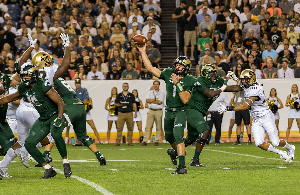 . Colorado State quarterback K.J. Carta-Samuels (1) throws against Colorado during first-half action in the Rocky Mountain Showdown Friday evening August 31, 2018 at Sports Authority Field in Denver. (Michael Brian/For the Reporter-Herald)