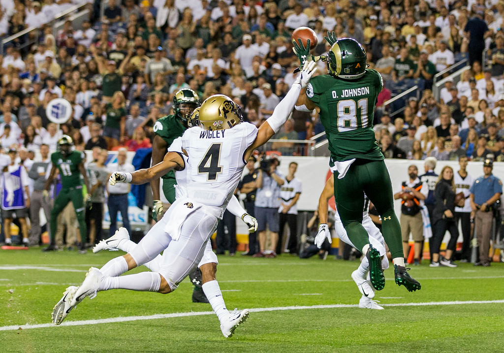 . Colorado State wide receiver Olabisi Johnson (81) grabs a touchdown catch against Colorado\'s Dante Wigley (4) during the Rocky Mountain Showdown Friday evening August 31, 2018 at Sports Authority Field in Denver. (Michael Brian/For the Reporter-Herald)