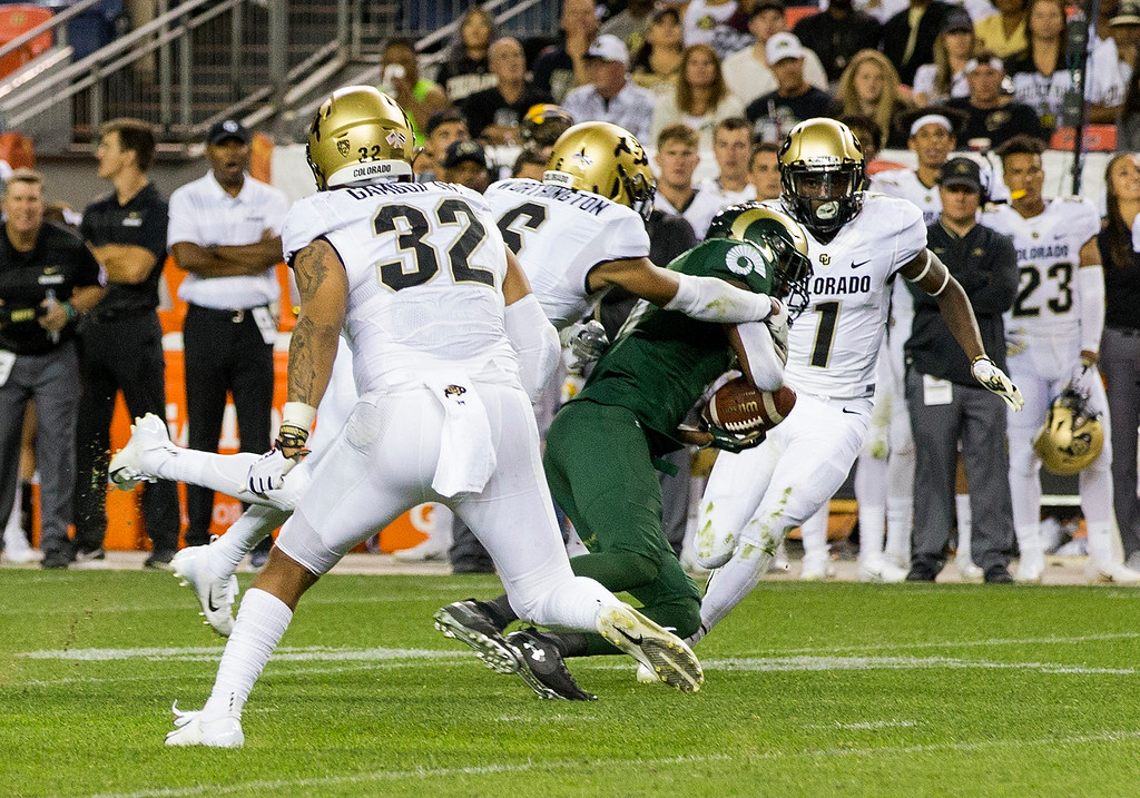. Colorado State wide receiver Preston Williams (11) catches a pass while surrounded in triple coverage during the Rocky Mountain Showdown Friday evening August 31, 2018 at Sports Authority Field in Denver. (Michael Brian/For the Reporter-Herald)