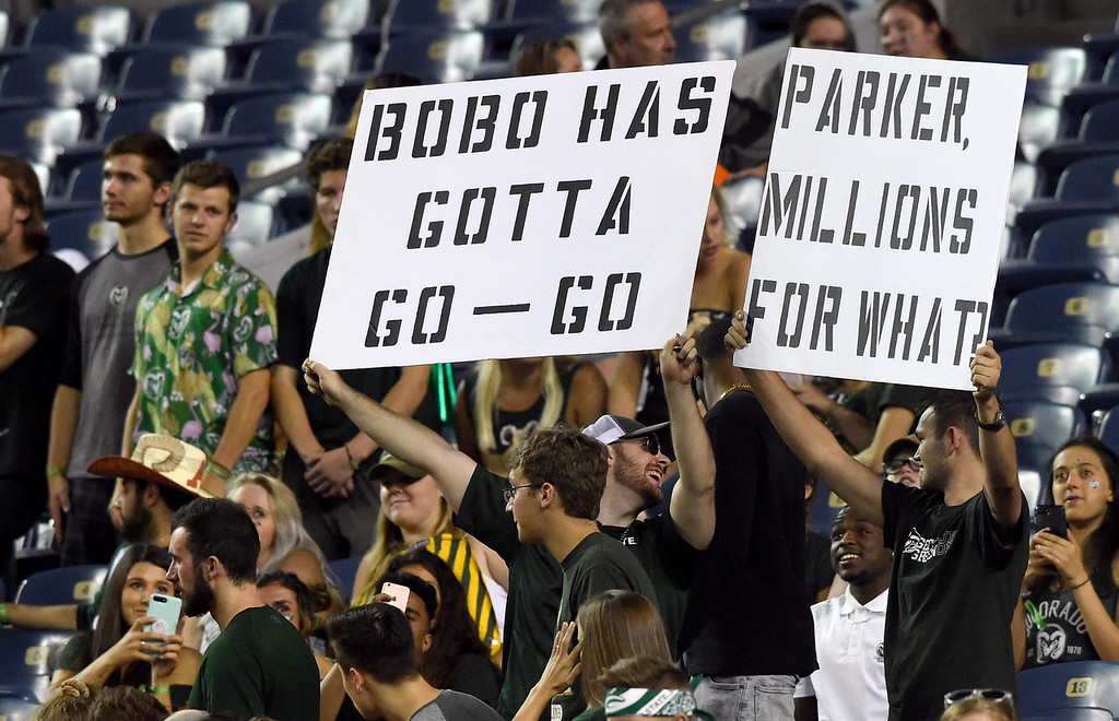. DENVER, CO - AUGUST 31, 2018: Colorado State University fans hold signs during the Rocky Mountain Showdown football game against the University of Colorado on Friday at Bronco\'s Stadium at Mile High in Denver. More photos: BoCoPreps.com (Photo by Jeremy Papasso/Staff Photographer)