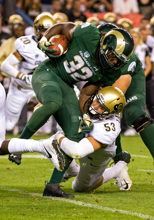 . Colorado\'s Nate Landman (53) tries to take down Colorado State running back Marcus McElroy during first-half action in the 2018 Rocky Mountain Showdown Friday evening August 31, 2018 at Sports Authority Field in Denver. (Michael Brian/For the Reporter-Herald)