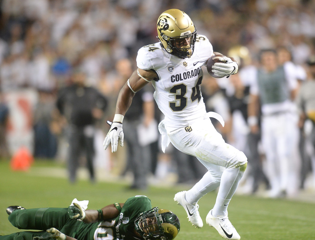 . DENVER, CO: August 31: Travon McMillian, of CU gets away from Tywan Francis, of CSU, during the second half on August 31, 2018 at Bronco Stadium at Mile High. (photo by Cliff Grassmick/Staff Photographer).