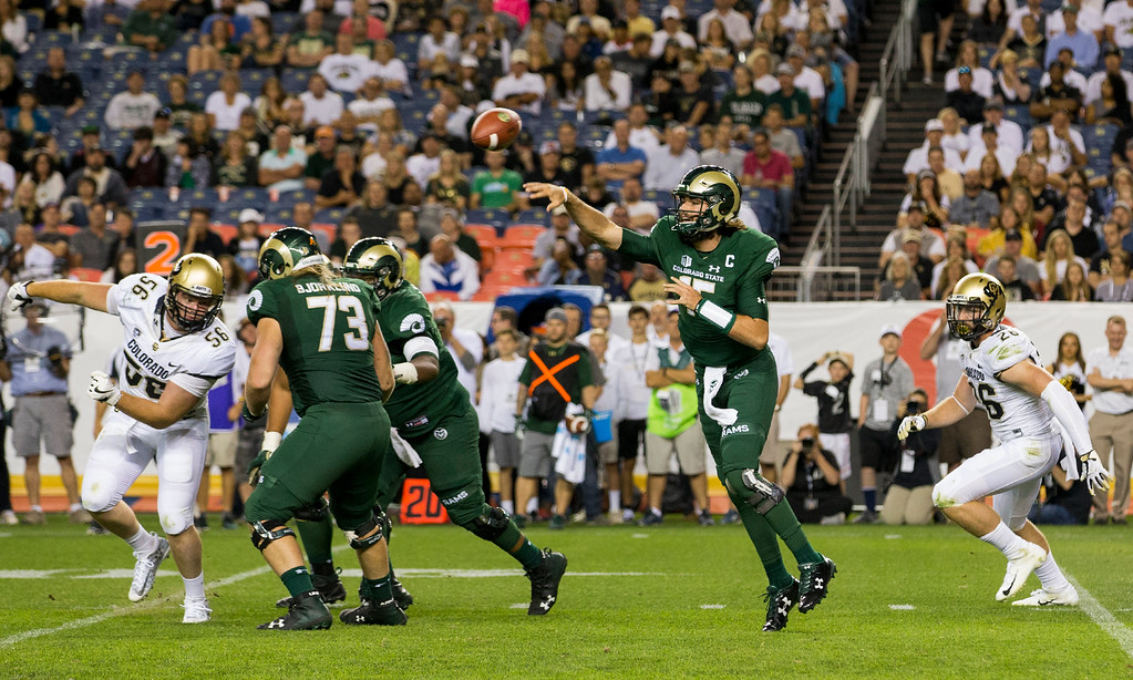 . Colorado State quarterback Collin Hill (15) throws a pass during the second half of the Rocky Mountain Showdown Friday evening August 31, 2018 at Sports Authority Field in Denver. (Michael Brian/For the Reporter-Herald)