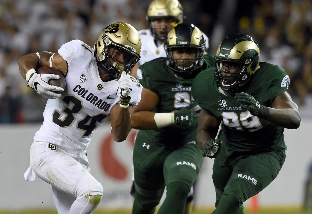 . DENVER, CO - AUGUST 31, 2018: University of Colorado\'s Travon McMillian runs for a touchdown during the Rocky Mountain Showdown football game against Colorado State University on Friday at Bronco\'s Stadium at Mile High in Denver. More photos: BoCoPreps.com (Photo by Jeremy Papasso/Staff Photographer)