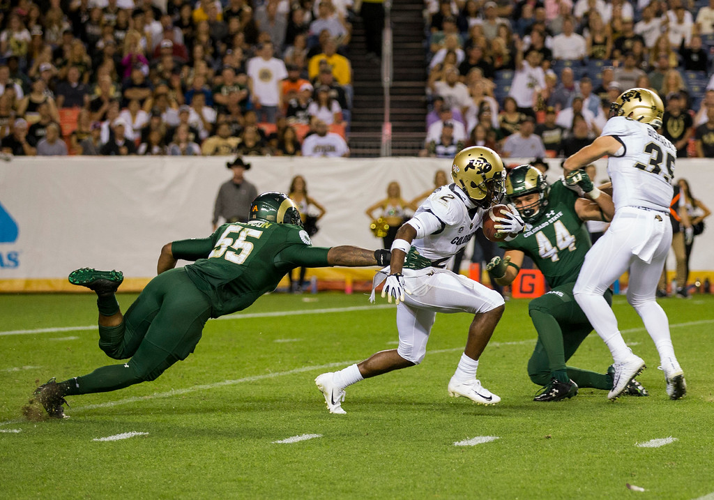 . Colorado State\'s Josh Watson (55) can\'t corral Colorado\'s Laviska Shenault, Jr., (2) during the Rocky Mountain Showdown Friday evening August 31, 2018 at Sports Authority Field in Denver. (Michael Brian/For the Reporter-Herald)