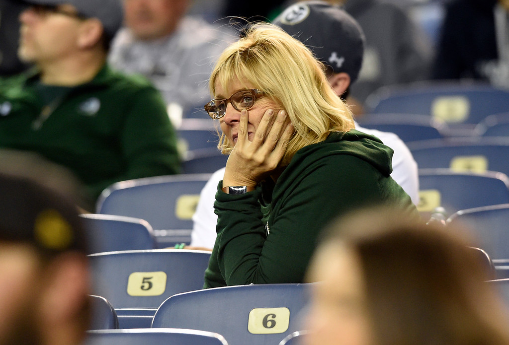 . DENVER, CO - AUGUST 31, 2018: A dejected Colorado State University fan sits in the stands at the end of the Rocky Mountain Showdown football game against the University of Colorado on Friday at Bronco\'s Stadium at Mile High in Denver. More photos: BoCoPreps.com (Photo by Jeremy Papasso/Staff Photographer)