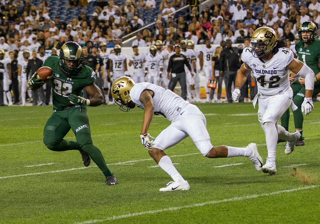 . Colorado State running back Marcus McElroy (32) can\'t get away from the Colorado defense to get out of the backfield during the Rocky Mountain Showdown Friday evening August 31, 2018 at Sports Authority Field in Denver. (Michael Brian/For the Reporter-Herald)