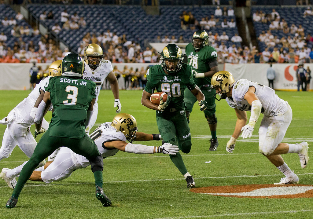 . Colorado State wide receiver Nikko Hall (80) runs for a long gain against Colorado during the Rocky Mountain Showdown Friday evening August 31, 2018 at Sports Authority Field in Denver. (Michael Brian/For the Reporter-Herald)