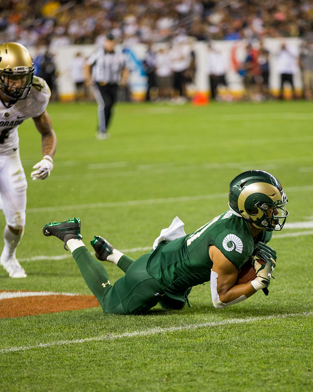 . Colorado State wide receiver Olabisi Johnson (81) makes a diving catch against Colorado during the Rocky Mountain Showdown Friday evening August 31, 2018 at Sports Authority Field in Denver. (Michael Brian/For the Reporter-Herald)